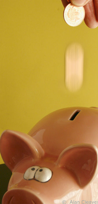 Piggy Bank - Saving Money in Real Estate